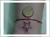 tatuagem estrela no pulso TARZIA TATTOO -