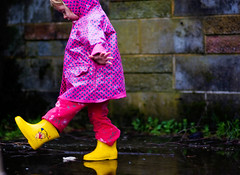 puddle fun, for Isa :-) (Le Fabuleux Destin d'Amlie) Tags: baby wet girl rain weather childhood wonder landscape fun puddle one kid toddler child play pentax explore blonde getty imagination raincoat gs pv forme gumboots 77mm twentyonemonths fa77 exploreflickr k10d smcpfa77mmf18 limitedlens stwell stsell