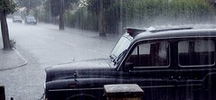 Hailing a Taxi (clarksworth) Tags: street storm water rain hail taxi derby