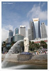 Merlion (Qli.C) Tags: city sculpture tourism water statue marina buildings singapore lion spray canon350d iconic vomit merlion gardencity singaporean famousicon   whitesculpture worldicon singaporemerlion tamron18250mm lionheadfishtail
