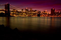 Peeking into the city (kjellarsen) Tags: city newyork brooklyn lights brooklynbridge newyorksunset mywinners colorphotoaward aplusphoto favemegroup3 favemegroup6 colourartaward platinumheartawards