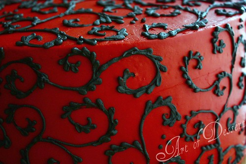 Red Cake with Black Scrolls - detail