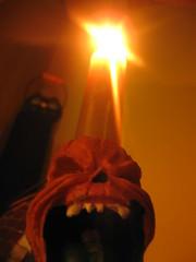 ahhhh! (Maʝicdölphin) Tags: light orange macro halloween canon skull candle powershot a590