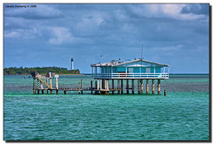 Jimmy Ellenburg's House and Cape Florida Lighthouse (Fraggle Red) Tags: house birds nationalpark raw florida soe stilts biscaynebay vob housesonstilts adobelightroom biscaynenationalpark stiltsville billbaggsstatepark capefloridalighthouse shieldofexcellence canonef70200mmf4lisusm concretepilings hdrqueen miamidadeco damniwishidtakenthat jimmyellenburghouse