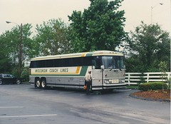 Wisconsin Coach Lines bus in the parking lot of the Kentucky Horse Farm. Lexington Kentucky. May 1990.