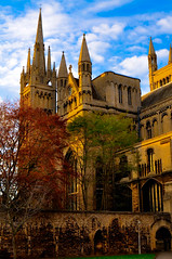 Cathedral. (Chris H#) Tags: blue autumn trees red brown green church sunshine architecture clouds cathedral gothic towers arches bluesky stonewalls peterborough s3000 placeofworship houseofgod nikond5000