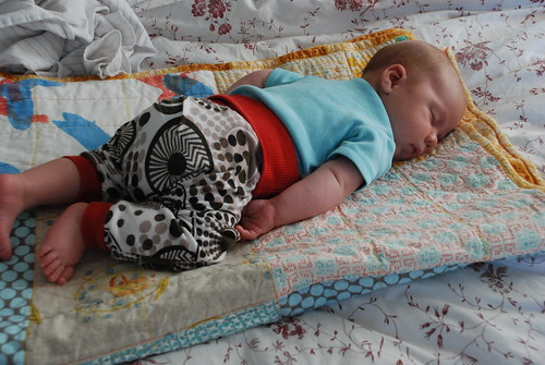 Tummy sleeper on his quilt