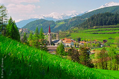 Town in Sudtirol (yuriye) Tags: italy sudtirol alps st lorenzen spring dolomite tirol trentinoalto adige südtirol alto trentino sud mountain landscape town sky grass green may yuriye snow church cathedral tree europe
