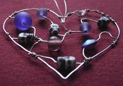 Purple Skully Heart - a suncatcher in beads and steel wire