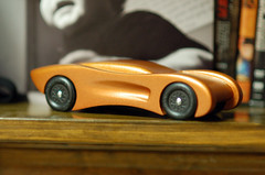 2008 Pinewood Derby Car (step 15, wheels on and aligned) (cdubya1971) Tags: wood columbus ohio orange car race racecar toy boyscouts scouts 2008 cary derby pinewood cubscouts bsa pinewoodderby csca whitt gravitycar pinewoodderbycardesign