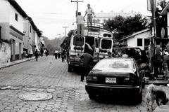 Embarque (Rai 幻の光) Tags: street camera blackandwhite art film monochrome 35mm canon vintage honda market guatemala rangefinder mercado civic canonet ql17 giii chichicastenango centralamerica chickenbus centroamerica adox chs100