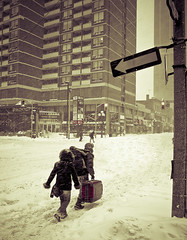 Say it ain't so (tomms) Tags: street winter red toronto canada storm cold travelling walking moving charles luggage oneway yonge savedbythedeletemeuncensoredgroup blursurfing