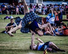Kilted Cartwheel (FotoFling Scotland) Tags: 2005 scotland kilt wrestler highlandgames bridgeofallan bridgeofallanhighlandgames davidblair robertclark scottishwrestlingbond wrestlingbond