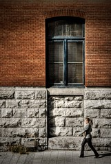 Just passing by.. (Michel Filion) Tags: street people canada brick window wall canon walking raw montreal brique michel rue mur fentre hdr filion 400d tamronspaf1750mmf28xrdiiildasphericalif rebelxti mike9alive michelfilion