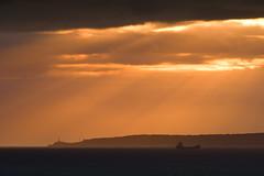 Ray Sandwich (Philipp Klinger Photography) Tags: light sunset sea sky orange lighthouse mist water clouds spain mediterranean ray ship silhouettes espana rays outlines mallorca palma philipp espanya klinger superaplus aplusphoto dcdead