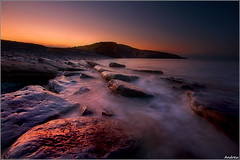 My First Sunrise (andrewwdavies) Tags: longexposure sea cold water sunrise geotagged rocks pastel earlymorning shades explore frontpage verycold southerndown circularpolariser wetfeet giap canonefs1022mmf3545 explored dunravenbay glamorganheritagecoast wfcmeet canoneos40d mistywater andrewwilliamdavies witchspoint geo:lat=51446338 geo:lon=3606187