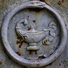 Ouroboros (Uroborus) with lamp (Leo Reynolds) Tags: lamp cemetery canon eos 50mm snake iso400 squaredcircle serpent ouroboros cemeterysymbol uroborus f67 sqparis 0ev 40d cemeteryperelachaise hpexif 0011sec groupcemeterysymbolism sqrandom xsquarex sqset032 xleol30x xratio1x1x xxx2008xxx