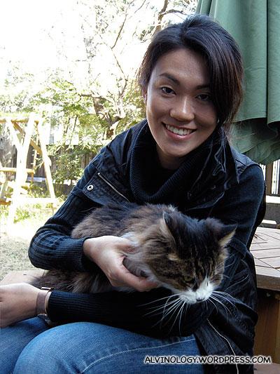 Rachel stroking the fat cat in the Asais garden
