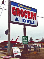 South Tacoma corner store () Tags: auto street camera city urban beach church bike bicycle sign shop corner tickets photography for washington store interesting highway view cross angle state pacific northwest image sale grain picture gritty neighborhood lottery photograph 99 repair sound processing deli local tacoma olympic roadside grocery atm cruiser puget mart southtacomaway