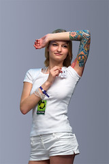 The colored female tattoo #3 (Oleg Mirabo) Tags: portrait woman white cute sexy art girl beautiful beauty fashion tattoo lady female stpetersburg person model glamour pretty russia young lifestyle style sensual international convention attractive elegance caucasian femininity tattooed 2011