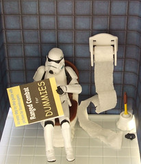Toilet break. (waihey) Tags: book hand stormtroopers toilet cubicle study steal hasbro toiletbrush toiletroll tk421 studyaid booksfordummies howtoguide
