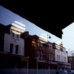 Orbs (Society Works) Tags: reflection 120 6x6 film buildings mediumformat lights shadows globes p6 kodakektachromee200 pentacon6tl carlzeissjenabiometar80mmf28