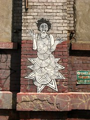 Street graffiti by Feral, DUMBO, Brooklyn, NY