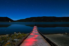 The Solitude of Self Nocturnality (Fort Photo) Tags: longexposure blue vacation sky lake selfportrait lightpainting reflection nature night stars landscape outdoors star evening pier nikon bravo nightscape nocturnal pacific northwest bend nps or astrophotography pacificnorthwest astronomy volcanic pnw nocturne nationalmonument afterdark eastlake d300 newberry catchycolorsblue newberrynationalvolcanicmonument impressedbeauty nocturnality 2008reunionnature