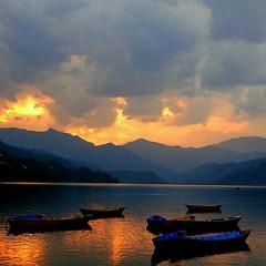 Set on Fire..... (albert_8) Tags: nepal sunset lake snow sunrise trek boat pokhara phewa annapurna sarangkot sarankot