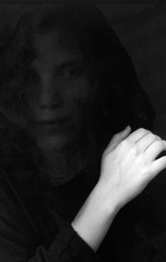 P. / black veil (YYL Photography) Tags: people blackandwhite bw woman white black macro art film blanco girl face mystery dark person blackwhite nikon noir hand veil noiretblanc negro el hidden 55mm micro mysterious nikkor makro notdigital bianco blanc nero biancoenero nikkormat toosmall negroyblanco micronikkor availabledarkness nikkormatel yylphotography