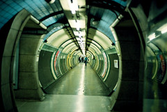 Retreat! Retreat! (Ouendi) Tags: people music london film lines underground lyrics curves tube perspective corridor tunnel 135 embankment nikonfe2 65daysofstatic 50mmf18 nikkorais fujicolorsuperiaxtra400