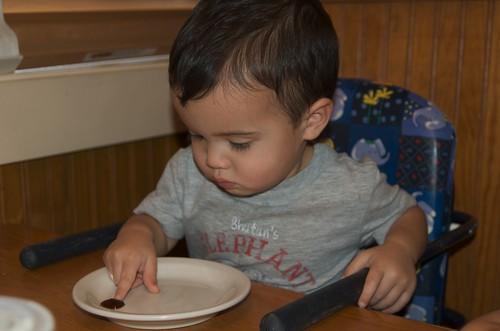 Benji tasting the sweet bbq sauce