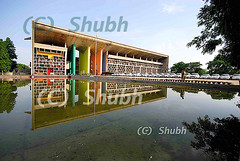 Punjab and Haryana High Court-Chandigarh (Shubh M Singh) Tags: india man reflection building cars colors architecture concrete energy alone power symmetry le fleet policeman corbusier chandigarh grandeur