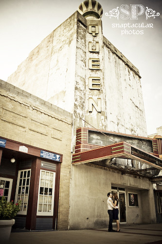 amy and todd in front of the queen movie theater engagement session bryan, tx