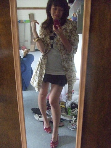 Floral Coat, Forever 21; Fox Graphic Shirt, UO; Black Flair Skirt, Bisou-Bisou; Red Sandals, Calkin Klein