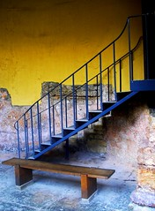 up the stairs (ssj_george) Tags: door uk blue england brown color up yellow stairs composition contrast bench bath europe colours roman olympus fave baths sit column exit bathspa soe romanbaths aplusphoto flickrelite 200850plusfaves vanagram grouptripod dragondaggeraward luxtop100