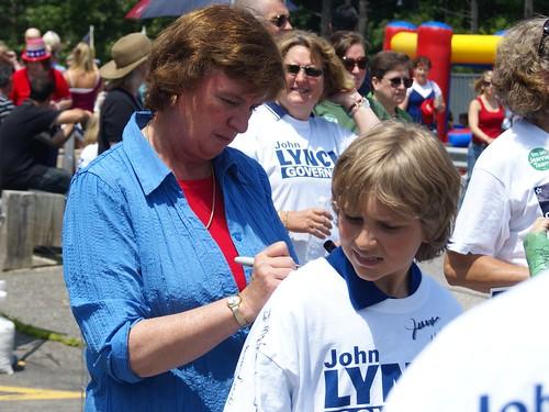 Carol Shea-Porter signing Logan's shirt