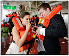The couple that inflates together, stays together. (Ryan Brenizer) Tags: wedding woman man love fun groom bride nikon funny florida july cruiseship royalcaribbean 2008 porteverglades 2470mmf28g michelleandtj