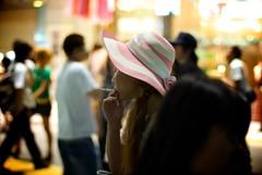 shibuya smoker (- reuben -) Tags: pink light girl hat japan night 50mm tokyo pentax bokeh smoke crowd shibuya smoking k10d
