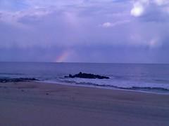 Partial Rainbow (1987porsche944) Tags: cameraphone ocean sea clouds newjersey rainbow nj stormy rainy monmouthcounty longbranch motorolav3razr piervillage partialrainbow