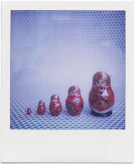 .the family of yue. (andrenzo) Tags: blue red color love film colors composition polaroid sx70 photography photo dof bokeh dream dreams intro 70 colori pola sx matriosca pellicola istantanea matriosche introcoso andrenzo andreacolombo introvertevent colomboandrea