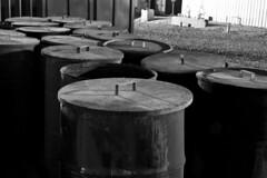 barrels (sabroso10) Tags: blackandwhite bw cooking metal nikon desert barrels steel iraq grease container lids bucca d40