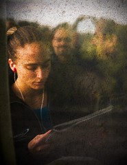 Yet another reflection. (Michel Filion) Tags: people reflection travelling texture window girl face canon reading raw michel filion 40d tamronspaf1750mmf28xrdiiildasphericalif mike9alive michelfilion