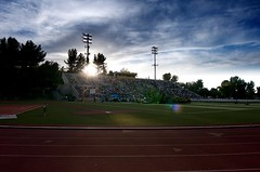COC Stadium (bredgur) Tags: school trees sky people students valencia field cowboys clouds lights book parents football track glare chairs stadium stage crowd graduation ceremony photobook canyon highschool staff seats lensflare commencement footballfield bleachers teachers chs graduates coc grads cougars blurb santaclarita canyoncountry graduationceremony collegeofthecanyons canyonhighschool canyoncowboys