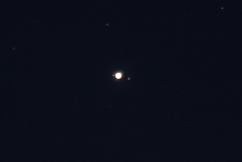 Jupiter and two Galilean moons
