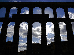 Aqueduct, late afternoon (damiancorrigan) Tags: travel sunset sky urban silhouette clouds spain nikon europa europe roman streetphotography aqueduct espana segovia urbanphotography d60 travelphotography romanaqueduct castillayleon europeantravel nikond60 castileleon