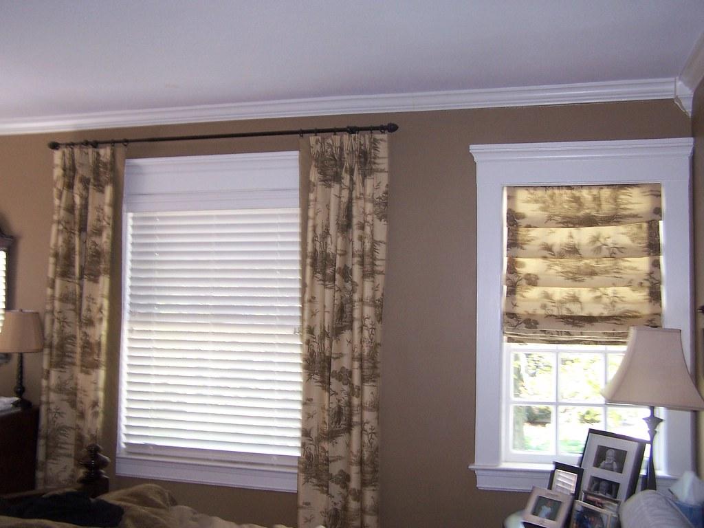 Pinch pleat panels and roman shade