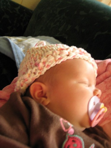 Baby Rose chilling in her hat