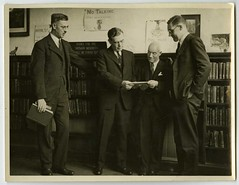 Ernest J Bell and three other men in Canterbury Public Library Younger Members' section