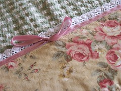 Shabby chic roses on a tea towel - trimmed with lace and a bow.